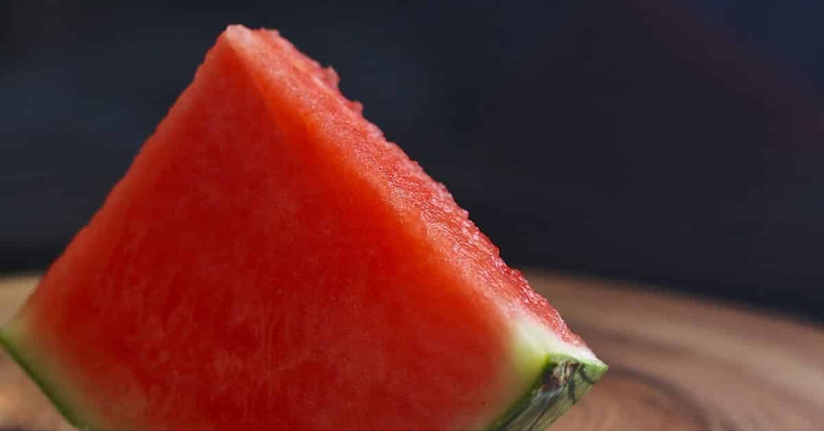 single slice of seedless watermelon on wooden table