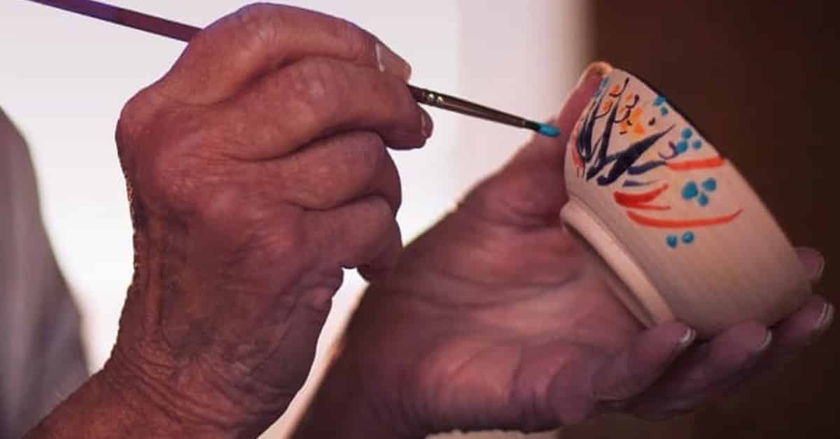 painting teacup hands