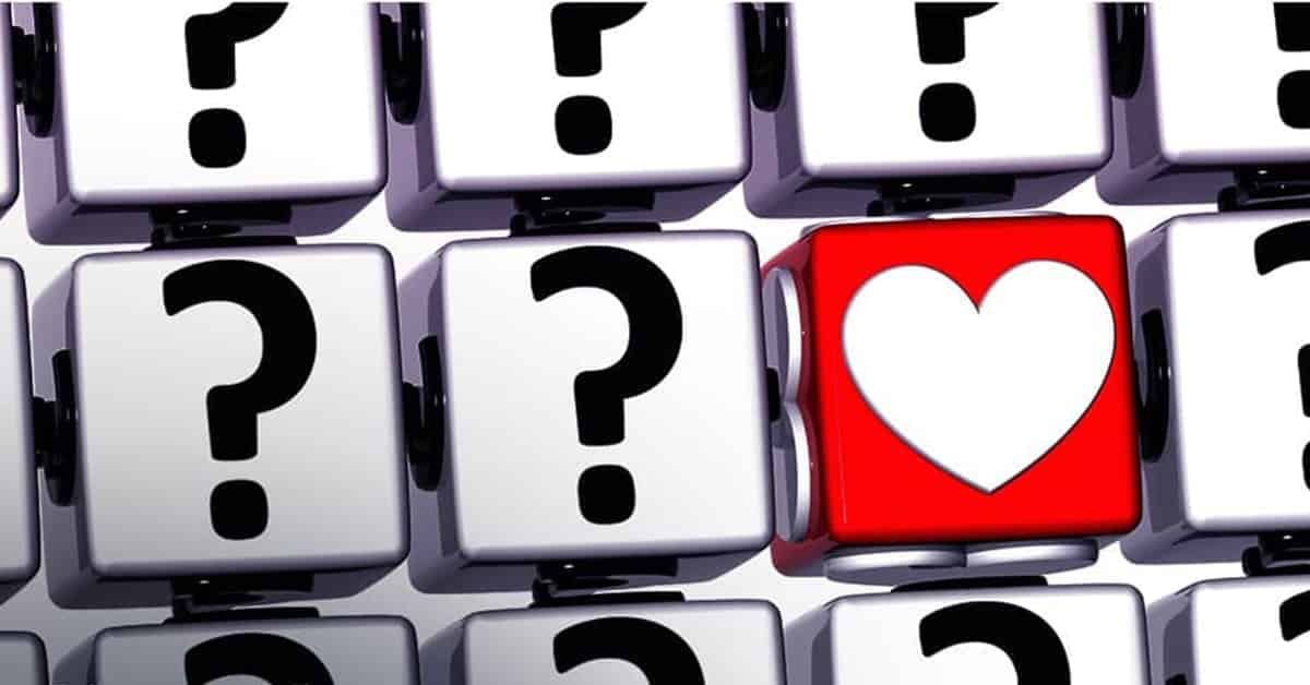 keyboard with all question marks and one red heart