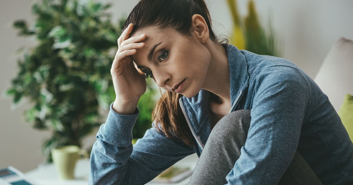 woman looking worried in running clothes