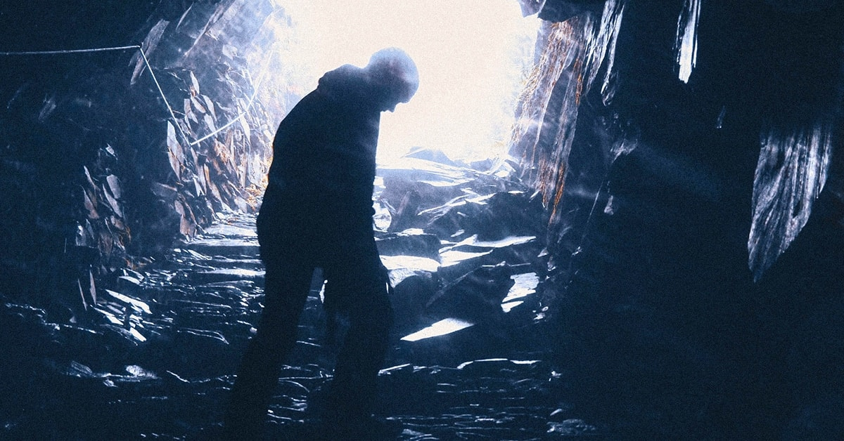 man learning about failure in cave