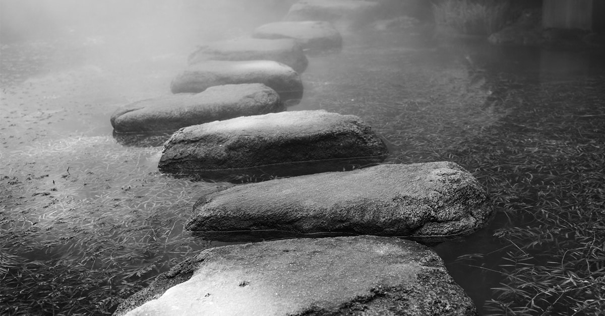 stepping stones across gray river