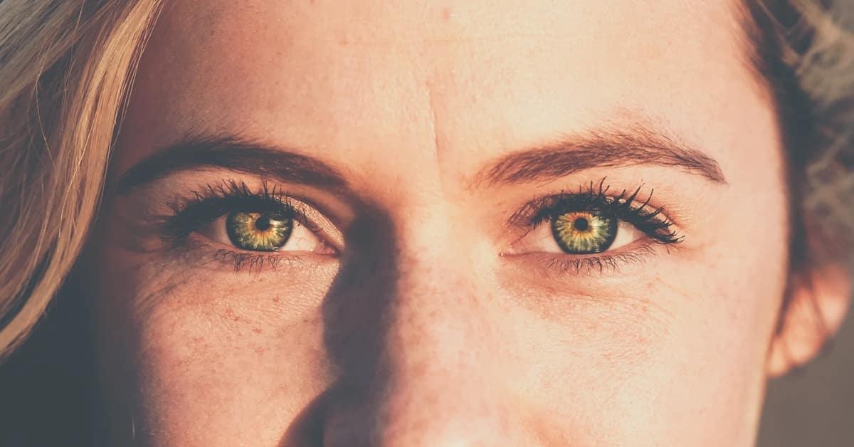 woman piercing green eyes