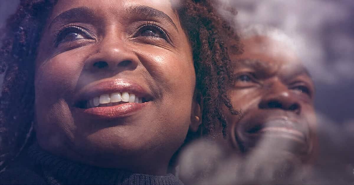 older black couple smiling wistfully