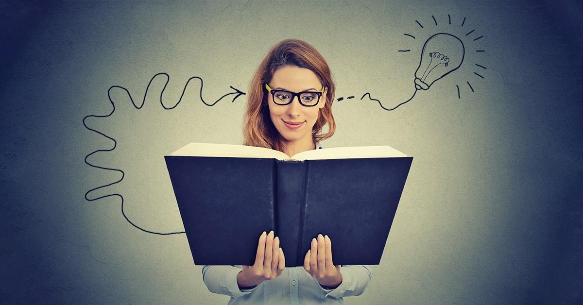 woman reading big book